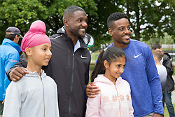 © Licensed to London News Pictures. 28/7/2016. Birmingham, UK.  More than 150 athletes, officials and staff representing USA Track & Field (USATF) are staying in Birmingham at the end of July, ahead of the IAAF World Championships in London. Pictured, USA track stars Justin Gatlin and Isiah Young joined local Birmingham children taking part in a sports event at a nearby park. Photo credit: Dave Warren/LNP