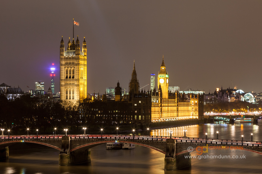 A night view of The Houses of Parliament, the Palace of Westminster and Big Ben. Lambeth Bridge and the River Thames can be seen in the foreground, as captured from Albert Embankment. A twilight cityscape of London in England, UK.