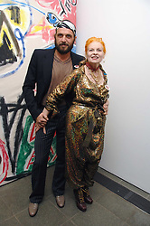 DAME VIVIENNE WESTWOOD and her husband MR ANDREAS KRONTHALER at a party to celebrate the publication of Vivienne Westwood's Opus held at The Serpentine Gallery, Kensington Gardens, London W2 on 12th February 2008.<br />