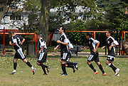 The undefeated Deportivo Colomex regroups after their first goal is scored against Team Shlama (Blue) during National Soccer League play in Skokie, Il.