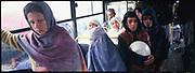 Men and women inside a bus in Kabul.