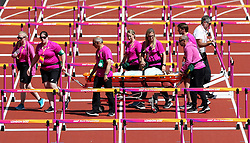 Trinidad and Tobago's Deboard John is removed on a stretcher following a fall in the Women's 100m hurdles heats during day eight of the 2017 IAAF World Championships at the London Stadium. PRESS ASSOCIATION Photo. Picture date: Friday August 11, 2017. See PA story ATHLETICS World. Photo credit should read: Jonathan Brady/PA Wire. RESTRICTIONS: Editorial use only. No transmission of sound or moving images and no video simulation.