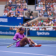2019 US Open Tennis Tournament- Day Seven.  Serena Williams of the United States rolls her ankle and falls over during her match against Petra Martic of Croatia in the Women's Singles round four match on Arthur Ashe Stadium during the 2019 US Open Tennis Tournament at the USTA Billie Jean King National Tennis Center on September 1st, 2019 in Flushing, Queens, New York City.  (Photo by Tim Clayton/Corbis via Getty Images)