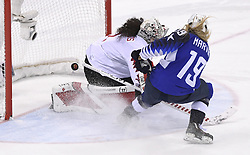 February 22, 2018 - Pyeongchang, South Korea - GIGI MARVIN of Team USA gets a penalty shot past Canada goalie SHANNON SZABADOS in the shootout of their 3-2 overtime win over Canada in the Women's Gold Medal Ice Hockey game Thursday, February 22, 2018 at Gangneung Hockey Centre at the Pyeongchang Winter Olympic Games. Photo by Mark Reis, ZUMA Press/The Gazette (Credit Image: © Mark Reis via ZUMA Wire)