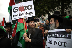 © Licensed to London News Pictures. 09/09/2015. London, UK. Jewish protestors carry Pro-Palestinian placards outside the gates of Downing Street ahead of a visit by Israeli Prime Minister Benjamin Netanyahu tomorrow.  Photo credit: Peter Macdiarmid/LNP