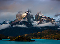 NATIONAL PARK TORRES DEL PAINE, CHILE - CIRCA FEBRUARY 2019: Sunset over the Paine Mountain Range and Lake Pehoe in Torres del Paine National Park, Chile.