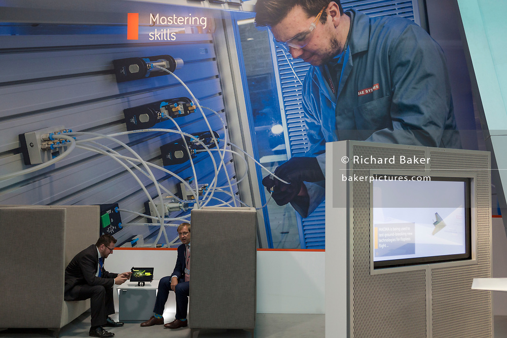 Interior of the BAE Systems exhibition hall at the Farnborough Airshow, on 18th July 2018, in Farnborough, England.