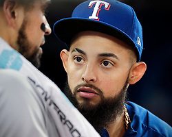 April 29, 2018 - Toronto, ON, U.S. - TORONTO, ON - APRIL 29: Texas Rangers Second base Rougned Odor (12) (currently on the DL) talks to a teammate in the Texas dugout during the MLB game between the Texas Rangers and the Toronto Blue Jays on April 29, 2018 at Rogers Centre in Toronto, ON. (Photo by Jeff Chevrier/Icon Sportswire) (Credit Image: © Jeff Chevrier/Icon SMI via ZUMA Press)