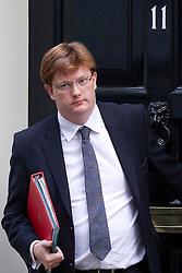 © Licensed to London News Pictures. 26/11/2013. London, UK. The Treasury Secretary, Danny Alexander, leaves Number 10 Downing Street after a meeting of British Prime Minister David Cameron's Cabinet on Downing Street in London today (26/11/2013). Photo credit: Matt Cetti-Roberts/LNP