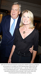 MR DAVID McDONOUGH and LADY MARY-GAYE CURZON at a party in London on 9th September 2002.PDA 48
