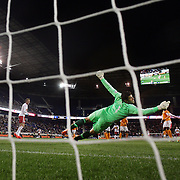 Houston Dynamo goalkeeper Tally Hall makes a fine save from Bradley Wright-Phillips, New York Red Bulls, during the New York Red Bulls V Houston Dynamo, Major League Soccer regular season match at Red Bull Arena, Harrison, New Jersey. USA. 23rd April 2014. Photo Tim Clayton