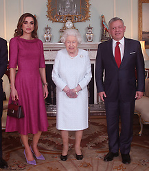 Queen Elizabeth II with Queen Rania of Jordan and King Abdullah II of Jordan, during a private audience at Buckingham Palace, London.