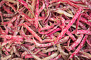 Pink red colour Demi-sec dried beans at the Capo street market for fresh food in Palermo, Sicily, Italy