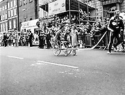 The finish of the Dublin City Marathon, at St Stephen's Green. Using just hand power, Michael O'Rourke approaches the finish line, cheered on by the crowd, to win the wheelchair event.<br />