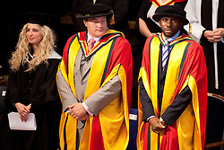© Licensed to London News Pictures. 13/07/2012. Bolton , UK . Bolton University awards footballer Fabrice Muamba (right) with an honorary degree in recognition of the medical professionals who saved his life . Photo credit : Joel Goodman/LNP