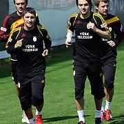 Galatasaray's players Sabri SARIOGLU (L), Caner ERKIN (R), Ugur UCAR (B) during their training session at the Jupp Derwall training center, Tuesday, April 20, 2010. Photo by TURKPIX