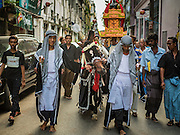 23 OCTOBER 2015 - YANGON, MYANMAR: A riderless horse representing Hussein ibn Ali's horse leads an Ashura procession in Yangon. Ashura commemorates the death of Hussein ibn Ali, the grandson of the Prophet Muhammed, in the 7th century. Hussein ibn Ali is considered by Shia Muslims to be the third imam and the rightful successor of Muhammed. He was killed at the Battle of Karbala in 610 CE on the 10th day of Muharram, the first month of the Islamic calendar. According to Myanmar government statistics, only about 4% of the population is Muslim. Many Muslims have fled Myanmar in recent years because of violence directed against Burmese Muslims by Buddhist nationalists.    PHOTO BY JACK KURTZ