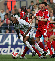 Photo: Paul Thomas.<br /> Bolton Wanderers v Liverpool. The Barclays Premiership. 30/09/2006.<br /> <br /> <br /> Nicolas Anelka (L) of Bolton is fouled by Momo Sissoko (C)and Stephen Finnan (R).