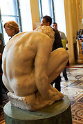 The crouching boy by Michelangelo at The State Hermitage Museum. A museum of art and culture in Saint Petersburg, Russia. The largest and oldest museum in the world, it was founded in 1754 by Catherine the Great and has been open to the public since 1852.