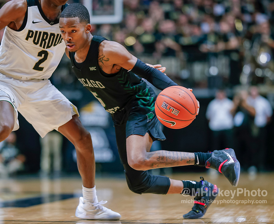 WEST LAFAYETTE, IN - NOVEMBER 16: Xavier Johnson #5 of the Chicago State Cougars brings the ball up court during the game against Eric Hunter Jr. #2 of the Purdue Boilermakers at Mackey Arena on November 16, 2019 in West Lafayette, Indiana. (Photo by Michael Hickey/Getty Images) *** Local Caption *** Xavier Johnson; Eric Hunter Jr.