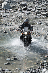 Kelly Modlin made his way through a fun spot as we were beginning to understand water would keep crossing our path on day-4 of our Himalayan Heroes adventure riding from Pokhara to Kalopani, Nepal. Friday, November 9, 2018. Photography ©2018 Michael Lichter.