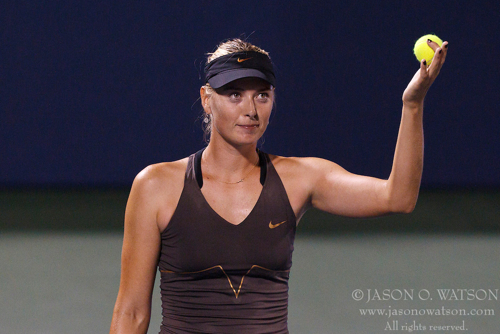 July 27, 2011; Stanford, CA, USA;  Maria Sharapova (RUS) gives away autographed tennis balls after the match against Daniela Hantuchova (SVK), not pictured, during the second round of the Bank of the West Classic women's tennis tournament at the Taube Family Tennis Stadium. Sharapova defeated Hantuchova 6-2, 2-6, 6-4.