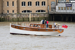 © Licensed to London News Pictures. 06/09/2017. LONDON, UK.  Dunkirk Little Ships and their owners arrive at St Katharine Docks, passing the Royal Navy base, HMS President on the River Thames, in preparation for the Classic Boat Festival this weekend. The Totally Thames Classic Boat Festival includes 40 vintage work boats, sailing and motor yachts and 14 of the Dunkirk Little Ships.  Photo credit: Vickie Flores/LNP