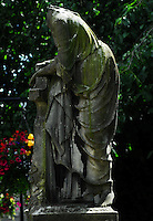 Headless Statue with a Cross on a Scottish Grave