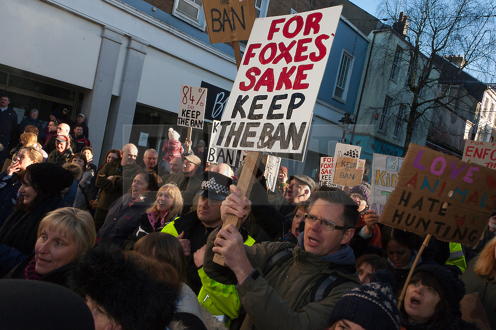 © Licensed to London News Pictures. 02/01/2017. Carmarthen, Carmarthenshire, Wales, UK. Anti-hunt protesters are blocked by police and hunt suporters from getting near the hunt. Anti-Bloodsport activists gather in the Welsh town of Carmarthen to voice their anger at the continued illegal hunting with dogs - hunting with dogs was made illegal in 2004 by The Hunting Act 2004 (c37). The Anti-Hunt protest takes place on the day that the Carmarthenshire Hunt have chosen to parade through the town to collect money and support for their blood-sports. Photo credit: Graham M. Lawrence/LNP
