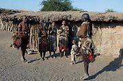 Datoga women singing and dancing outside their hut.   Lake Eyasi, northern Tanzania.