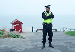© Licensed to London News Pictures. 13/03/2012. Saltburn, England. Police guardian the seafront at Saltburn, Cleveland today (13/02/2012) where armed police surrounded a person suspected of carrying a bomb in a bag. Photo credit : Ian Forsyth/LNP