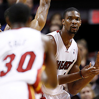 24 January 2012: Miami Heat power forward Chris Bosh (1) passes the ball to Miami Heat point guard Norris Cole (30) during the Miami Heat 92-85 victory over the Cleveland Cavaliers at the AmericanAirlines Arena, Miami, Florida, USA.