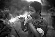 Child guerrilla with the Karen National Liberation Army. Both the government of Burma and guerrilla factions opposing the military junta use children as combatants.