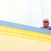 Khmer migrant worker at King's palace in Phnom Penh, Cambodia.