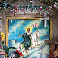 USA, New Mexico, Chimayo. Small shrine at Santuario de Chimayo.