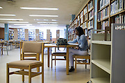 Melaysa Greer, a junior studying nursing at Grambling State University, works alone in the A.C. Lewis Library in Grambling, Louisiana on October 23, 2013.  (Cooper Neill for The New York Times)