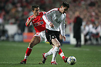 Photo: Lee Earle.<br /> Benfica v Liverpool. UEFA Champions League. 2nd Round, 1st Leg. 21/02/2006. Liverpool's Steve Finnan (R) holds off Laurent Robert.