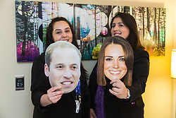 Deputy hotel Manager Nicky Gashtasbi and Assistant Manager Bruna Salvadori play with Duke and Duchess of Cambridge masks left behind by guests. London, July 24 2019.