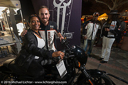 """Jana Hutchinson gets help from Tanner Pruett (H-D Consumer Event Marketing) on the Jumpstart bike at the Harley-Davidson display at """"Biking on the Boulevard"""" on Dr. Mary McLeod Bethune Blvd during Daytona Bike Week 75th Anniversary event. FL, USA. Friday March 11, 2016.  Photography ©2016 Michael Lichter."""