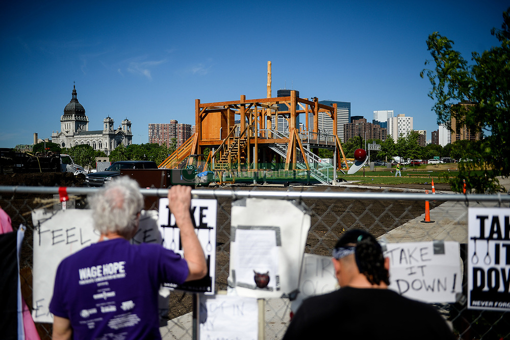 May 31, 2017 - Minneapolis, Minnesota, U.S. - PATRICK GREFFIN, of Minneapolis, left, and VIRGIL BLACKLANCE, from the Lower Sioux Indian Reservation, visited the site of a protest near Sam Durant's 'Scaffold' sculpture. A group of Dakota tribal elders met Wednesday with officials from the Walker Art Center and the Minneapolis Park Board to discuss the controversial 'Scaffold' sculpture. On December 26, 1862 on the day after Christmas, 38 Dakota (Santee Sioux) were put to death by hanging. The deaths were ordered by President Abraham Lincoln, the Great Emancipator. The hangings were the result of the Dakota War of 1862, which terminated the rights of Dakota people from living in Minnesota at that time. (Credit Image: © Aaron Lavinsky/Minneapolis Star Tribune/ZUMAPRESS.com)