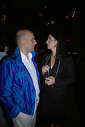 Mary McCartney and Mark Quinn, Established and Sons UK Launch during Design Week. The Bus Depot, Hertford Road. Hoxton. 22 September 2005.  ONE TIME USE ONLY - DO NOT ARCHIVE © Copyright Photograph by Dafydd Jones 66 Stockwell Park Rd. London SW9 0DA Tel 020 7733 0108 www.dafjones.com