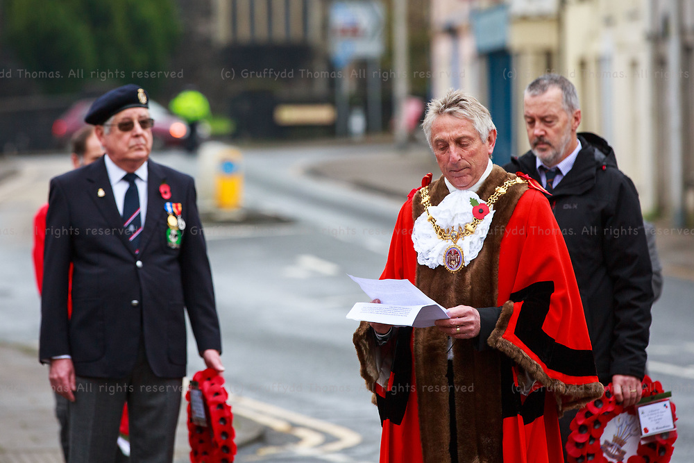 """Carmarthen, Carmarthenshire, Wales, UK. 8 November, 2020.<br /> The Mayor of Carmarthen Cllr Gareth John at a scaled-back Remembrance Day parade in Carmarthen, Carmarthenshire, west Wales due to Covid-19 """"fire break"""" restrictions.<br /> Credit: Gruffydd Ll. Thomas"""