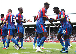 """Crystal Palace's Jeffrey Schlupp (right) celebrates scoring his side's first goal of the game with team-mate Patrick van Aanholt during the Premier League match at Craven Cottage, London. PRESS ASSOCIATION Photo. Picture date: Saturday August 11, 2018. See PA story SOCCER Fulham. Photo credit should read: Yui Mok/PA Wire. RESTRICTIONS: EDITORIAL USE ONLY No use with unauthorised audio, video, data, fixture lists, club/league logos or """"live"""" services. Online in-match use limited to 120 images, no video emulation. No use in betting, games or single club/league/player publications.during the Premier League match at Molineux, Wolverhampton. PRESS ASSOCIATION Photo. Picture date: Saturday August 11, 2018. See PA story SOCCER Wolves. Photo credit should read: Nick Potts/PA Wire. RESTRICTIONS: EDITORIAL USE ONLY No use with unauthorised audio, video, data, fixture lists, club/league logos or """"live"""" services. Online in-match use limited to 120 images, no video emulation. No use in betting, games or single club/league/player publications."""