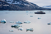 A cruise ship in the Arctic sea ice in Svalbard, Norway in July