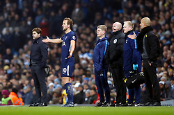 Tottenham Hotspur's Harry Kane waits to come back on the pitch after receiving treatment during the Premier League match at the Etihad Stadium, Manchester.