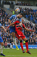 Football - 2017 / 2018 Premier League - Brighton and Hove Albion vs. Huddersfield Town<br /> <br /> Shane Duffy of Brighton climbs all over Mathias Jorgensen of Huddersfield Town to win a header at The Amex Stadium Brighton <br /> <br /> COLORSPORT/SHAUN BOGGUST