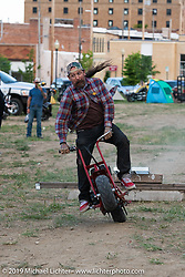 Slinging Ink tattoo artist Oliver Peck crashing on a mini-bike during the Run to Raton. Raton, NM. USA. Saturday July 21, 2018. Photography ©2018 Michael Lichter.