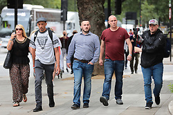 © Licensed to London News Pictures. 19/07/2019. London, UK. James Goddard (centre) arrives at Westminster Magistrates Court for the start of a two-day trial for harassment of Remain-supporting MP Anna Soubry. Photo credit: Rob Pinney/LNP
