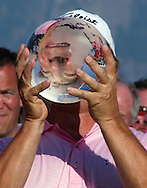David Eger hold up the trophy after winning the \Boeing Greater Seattle Classic in Snoqualmie, Wash. (AP Photo/John Froschauer)