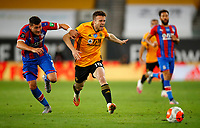 2019 / 2020 Premier League - Wolverhampton Wanderers vs Crystal Palace <br /> <br /> Joel Ward of Crystal Palace and Diogo Jota of Wolverhampton Wanderers  at Molyneux.<br /> <br /> Credit COLORSPORT/LYNNE CAMERON